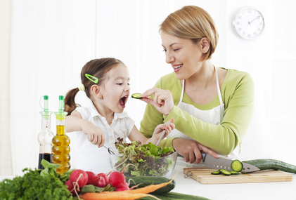 Mother and child makeing salad